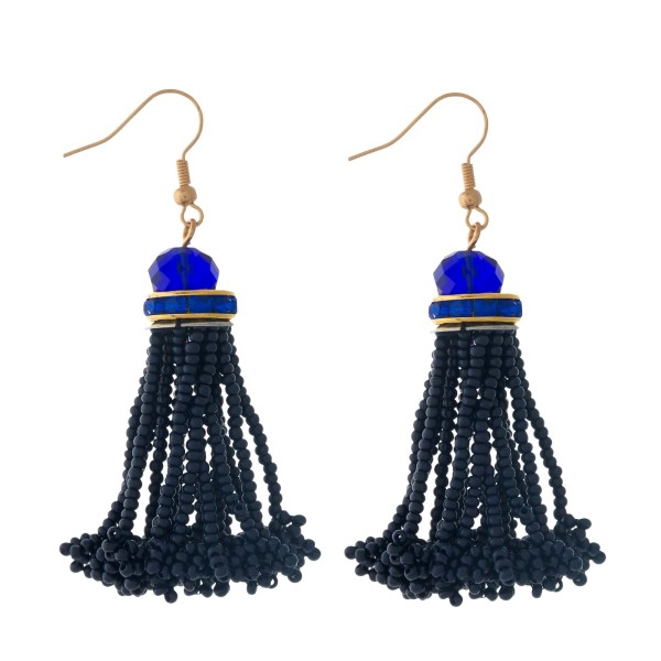 """Gold tone fishhook earrings with a navy blue, seed-bead tassel. Approximately 2"""" in length."""