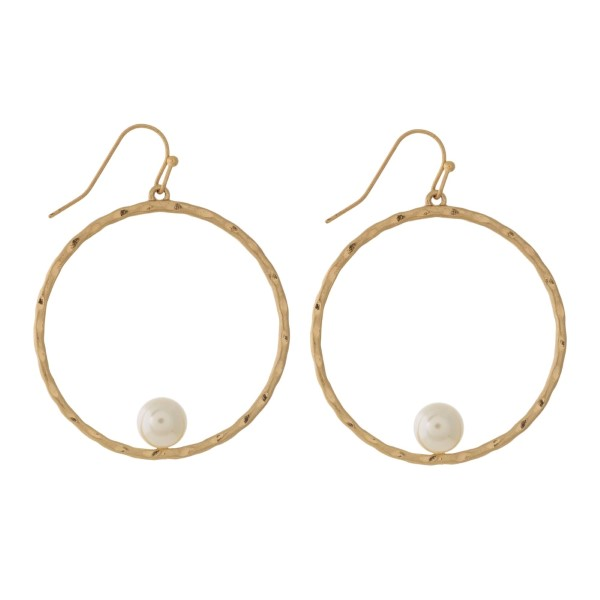 "Dainty, hammered metal, fishhook earrings with a pearl bead accents. Approximately 1.5"" in diameter."