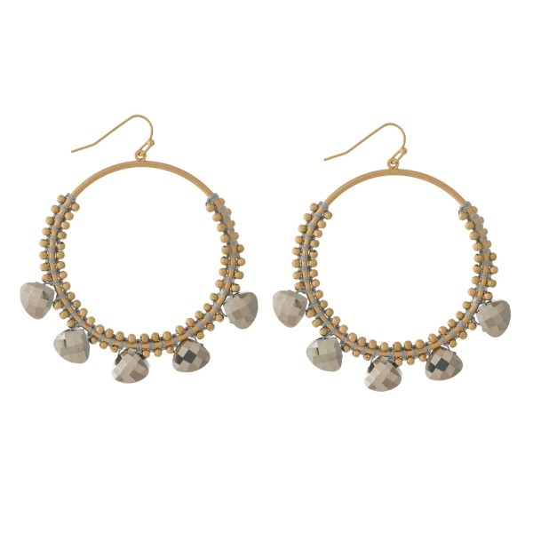 """Gold tone fishhook earrings with an open circle shape and gray beaded accents. Approximately 2"""" in diameter."""