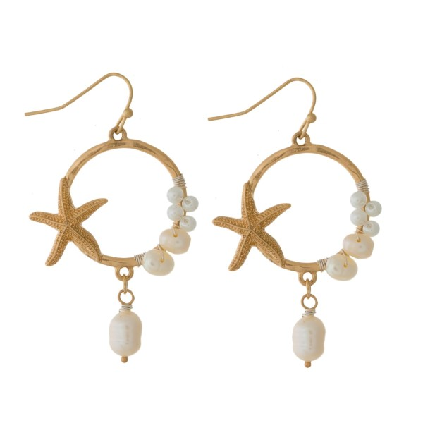 "Matte metal, fishhook earrings with wire wrapped pearl beads and a starfish accent. Approximately 2"" in length."