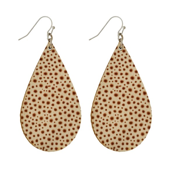 "Silver tone, fishhook earrings with a faux leather teardrop shape. Approximately 2.5"" in length."