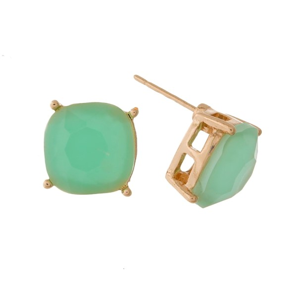 "Dainty, gold tone stud earrings with a faceted, square rhinestone. Approximately 1/2"" in size."