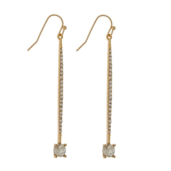 "Gold tone fishhook earrings with a pave bar and a circle rhinestone. Approximately 2.25"" in length."