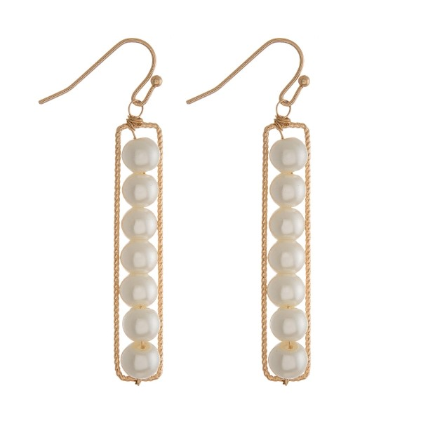 """Dainty fishhook earrings with pearl beads and a rectangle shape. Approximately 2.25"""" in length."""