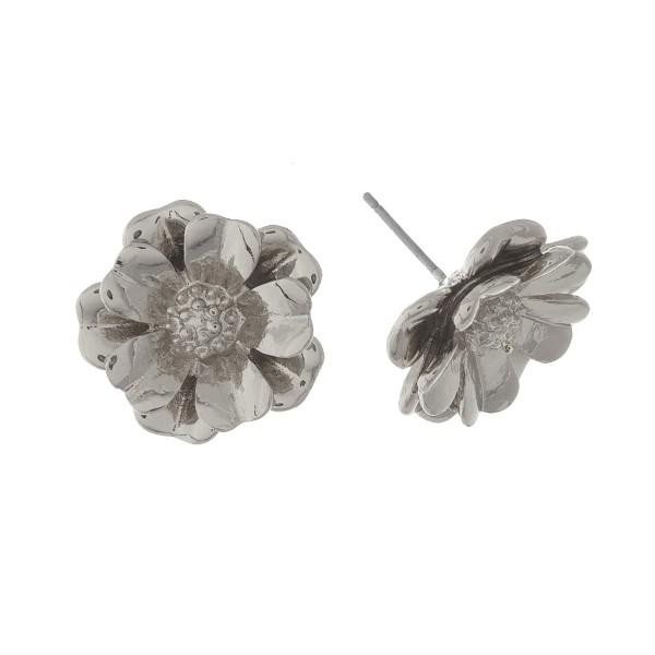 "Metal, flower shaped, stud earrings. Approximately 1/2"" in size."
