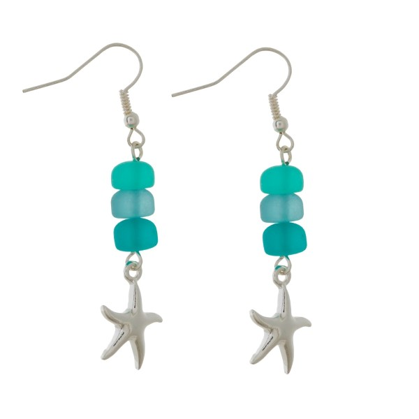 "Silver tone fishhook earrings with sea glass beads and a sea life charm. Approximately 1.5"" in length."