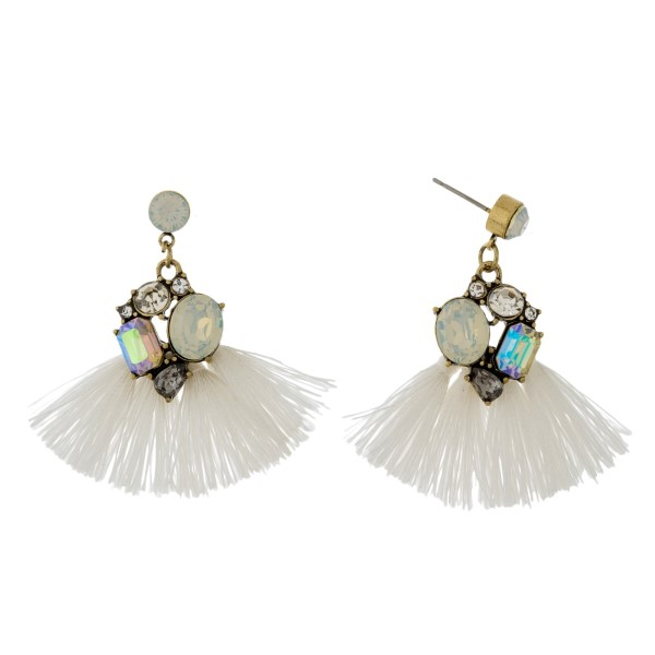 """Burnished gold tone statement earrings with monochromatic rhinestones and thread tassels. Approximately 1.75"""" in length."""