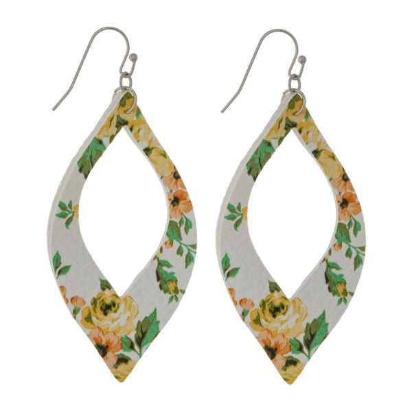"Silver tone fishhook earrings with a faux leather, cutout oval shape with a floral pattern. Approximately 2.25"" in length."