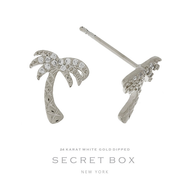 "Secret Box 24 karat white gold dipped over brass palm tree stud earrings. Approximately 1/2"" in length. Sold in a gift box."