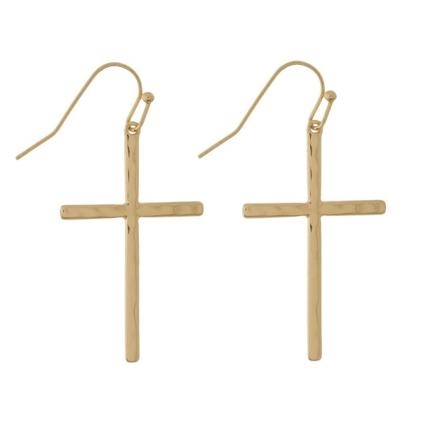 "Long fishhook earrings with hammered metal crosses. Approximately 1.5"" in length."