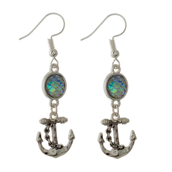 "Silver tone, fishhook earring with sea life charm. Approximately 1.5"" in length."