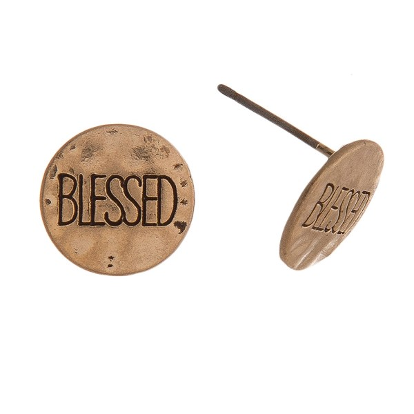"Metal stud earrings featuring ""Blessed"" engraved details. Approximately .5"" in diameter."