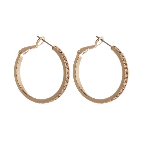 """Metal hoop earring with rhinestone detail. Approximately 1"""" in diameter."""