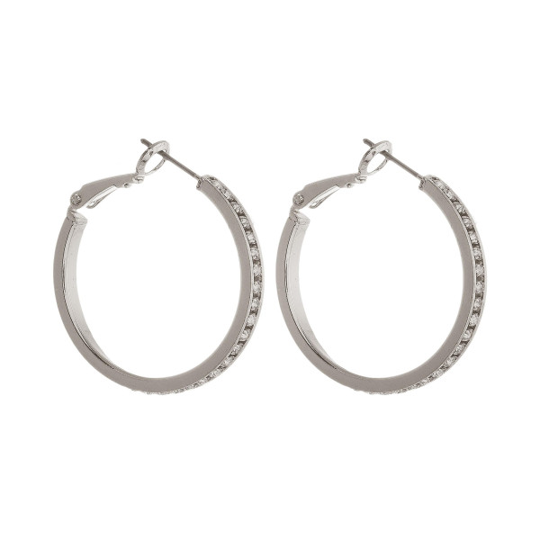 "Metal hoop earring with rhinestone detail. Approximately 1"" in diameter."