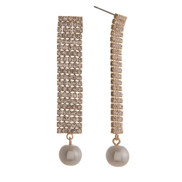"Stud earring with long rhinestone detailed bar accented with a pearl. Approximately 2"" in length."