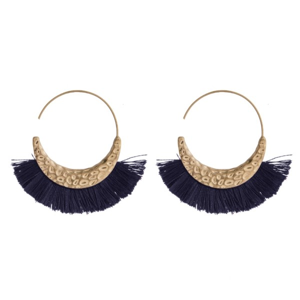 """Hammered gold tone hoop earring with fanned, soft tassel. Approximately 1.5"""" in length."""