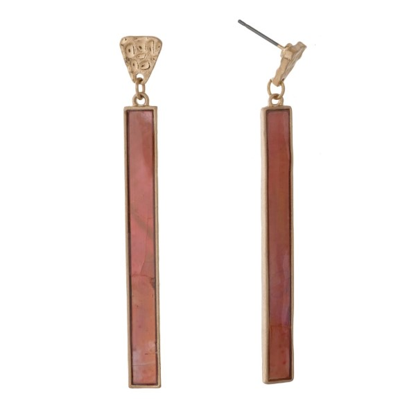 "Long, gold tone earring with natural stone accent. Approximately 3"" in length."
