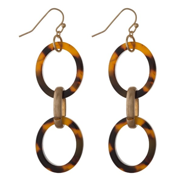 """Gold tone fishhook earring with linked acetate ovals. Approximately 2"""" in length."""