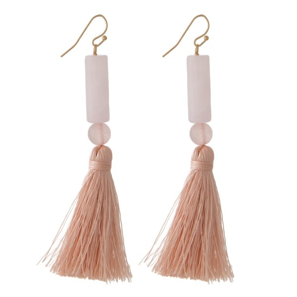 """Gold tone fishhook earring with natural stone beads and soft thread tassel. Approximately 3"""" in length."""