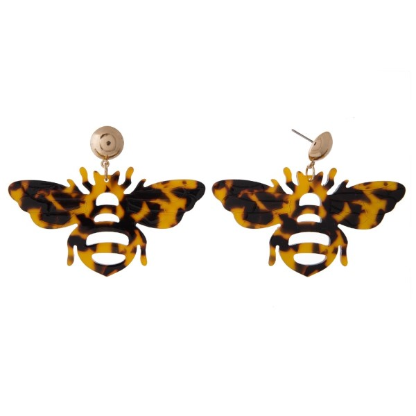 """Gold tone post earring with acetate bee shape. Approximately 1.5"""" in length and 2.5"""" in width."""