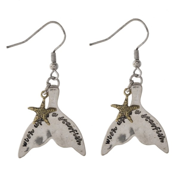 "Silver tone fishhook earring stamped with Wish Upon a Starfish and accented with a sea life charm. Approximately 1.5"" in length."