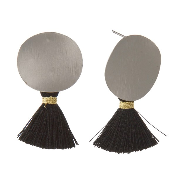 "Hammered metal circle earring with soft thread tassel. Approximately 1.5"" in length."