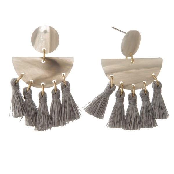 Stud acetate earring with soft tassels.