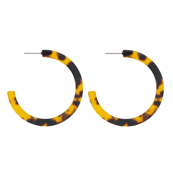 "Acetate hoop earring. Approximately 1.5"" in diameter."