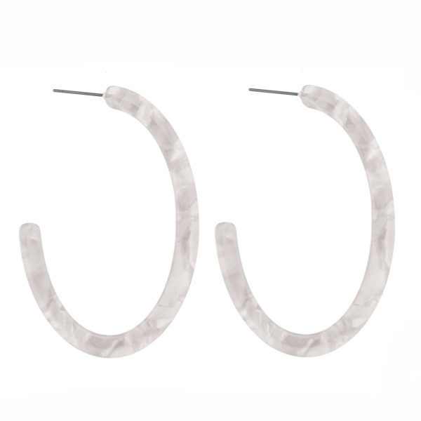 "Post acetate oblong hoop earring. Approximately 2"" in length."