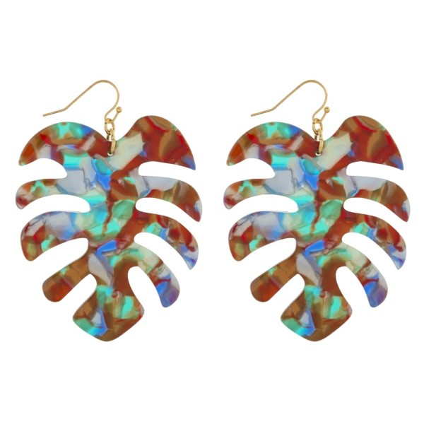 """Gold tone fishhook earring with acetate palm leaf design. Approximately 2"""" in length."""
