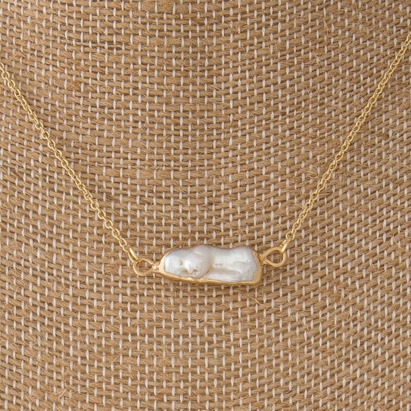 "Dainty necklace with freshwater pearl. Approximately 16"" in length."