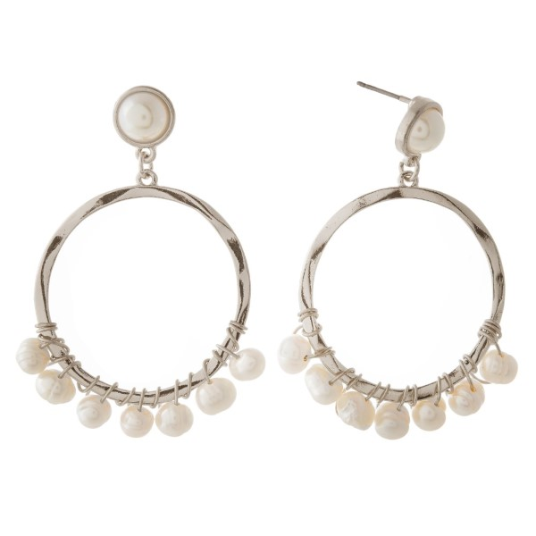 "Pearl stud earring with a circle shape. Approximately 1.5"" in length."