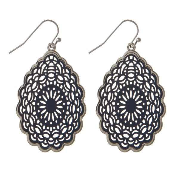 "Metal filigree earring. Approximately 1.5"" in length."
