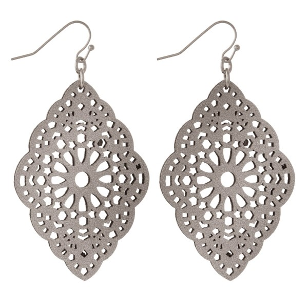 """Gold tone fishhook earring with filigree faux leather shape. Approximately 2"""" in length."""