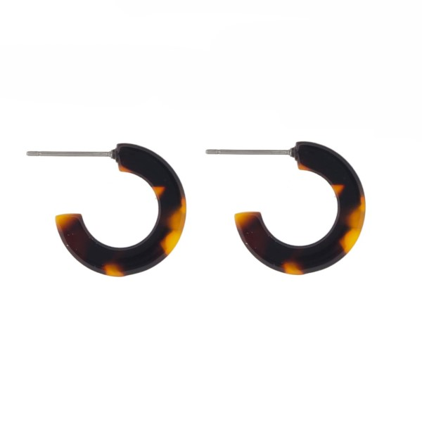 "Acetate hoop earring. Approximately 1/2"" in diameter."