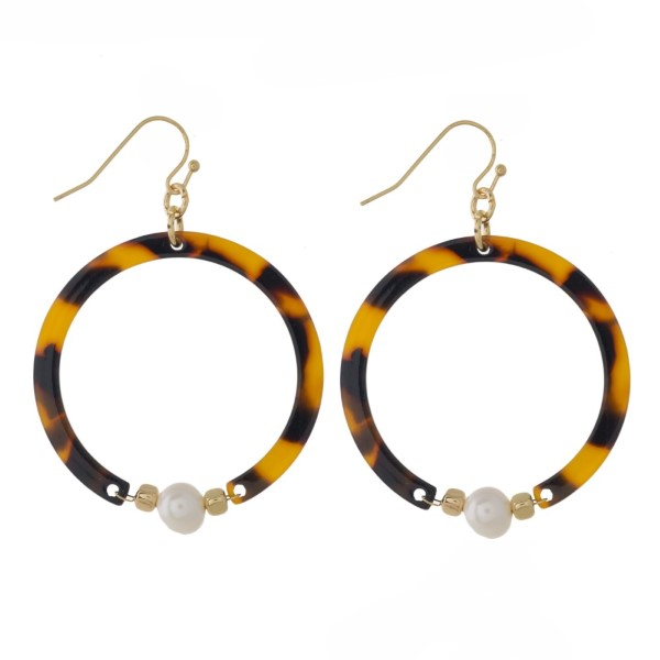 """Gold tone fishhook earring with acetate circle design and pearl accent. Approximately 1.5"""" in diameter."""