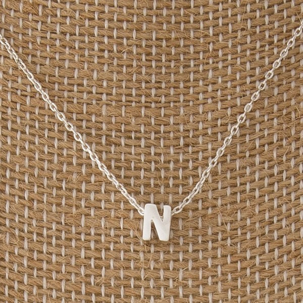 "Dainty necklace with initial charm. Approximately 16"" in length with a 1/4"" letter charm."