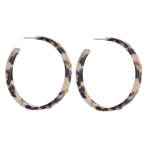 "Acetate hoop earring with stud detail. Approximately 2"" in diameter."