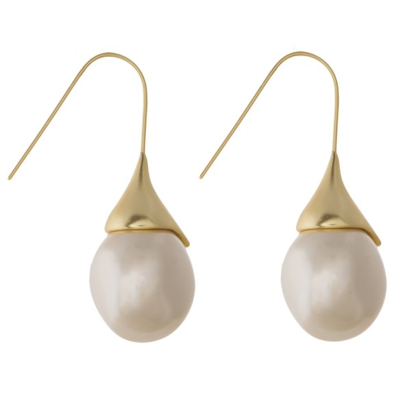 "Metal fishhook earring with pearl accent. Approximately 1.25"" in length."
