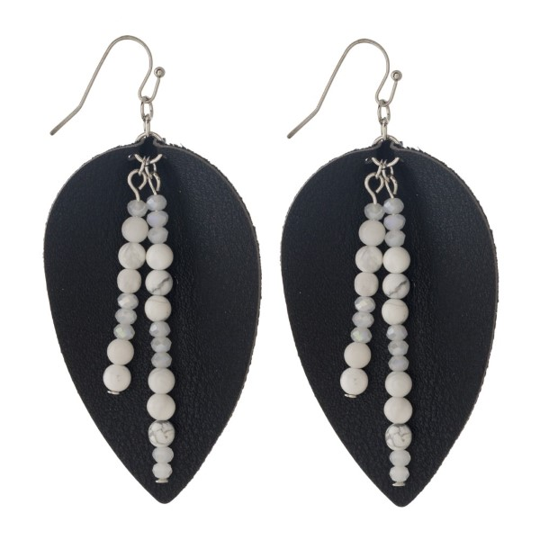 """Silver tone fishhook earring with leather teardrop shape and natural stone accent. Approximately 2"""" in length."""