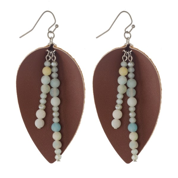 "Silver tone fishhook earring with leather teardrop shape and natural stone accent. Approximately 2"" in length."