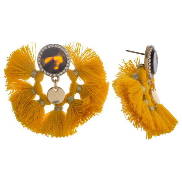 Circular tassel earring with rhinestones and acetate design. Approximate 1.5 in length.