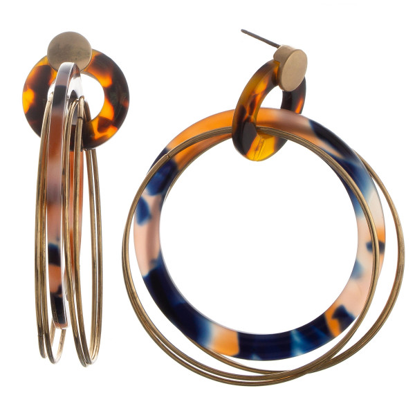 Round layered gold hoops with acetate hoop detail. Approximate 2.5: in length.