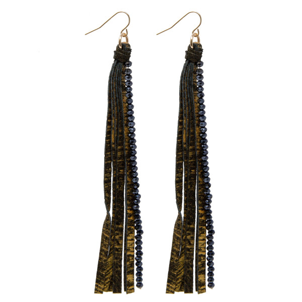 "Long faux leather earrings with faceted bead details. Approximately 4.5"" in length."
