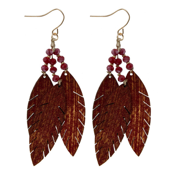 "Fishhook leather leaf earring with faceted bead detail. Approximately 2"" in length."