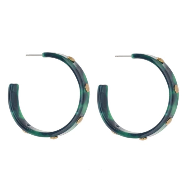 "Acetate hoop earring with gold stud accents. Approximately 1.5"" in diameter."
