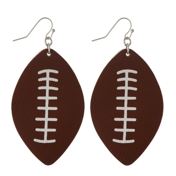 "Fishhook faux leather football earring. Approximately 2"" in length."