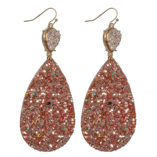 "Gold tone fishhook earring with faux druzy detail and glitter teardrop shape. Approximately 3"" in length."