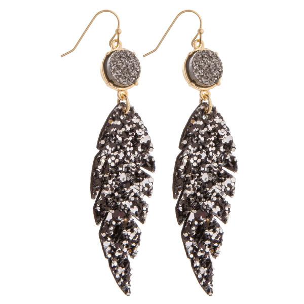 "Long feathered leather glitter earrings. Approximate 3"" in length"