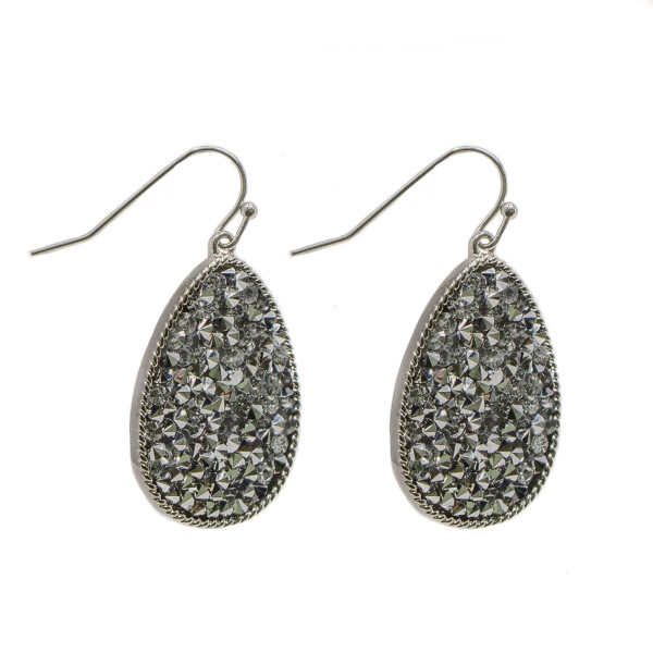 "Fishhook earring teardrop shape and rhinestone detail. Approximately 1"" in length."